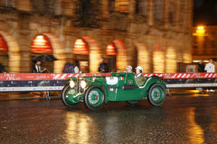 Green MG K3 Magnette, 1933, drives by the Arena di Verona during 1000 Miglia Royalty Free Stock Images