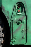 Green military vehicle door with handles and bolts Royalty Free Stock Images