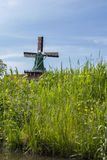 Green mill in the Netherlands in green field Stock Photo