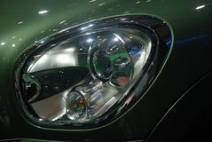 Green Mini cooper headlight Royalty Free Stock Photo
