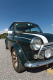 Green Mini Cooper perspective view. Perspective view of a Limited Edition Mini Cooper with the headlight in the foreground Stock Images