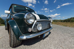 Green Mini Cooper. A perspective view of an old Mini Cooper on a sunny day Royalty Free Stock Image