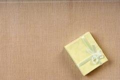 Green mini gift box with ribbon Royalty Free Stock Image