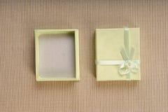 Green mini gift box with ribbon Stock Photos