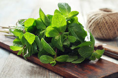 Green mint leaves. With lime on wooden background Royalty Free Stock Photos