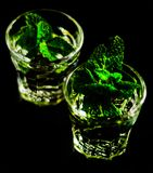 Green mint liqueur, refreshing drink with fresh mint, energizing. Cocktail, party night Royalty Free Stock Photos