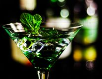 Green mint liqueur, refreshing drink with fresh mint, energizing. Cocktail, party night Stock Photography