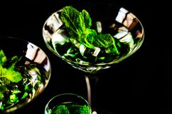 Green mint liqueur, refreshing drink with fresh mint, energizing. Cocktail, party night Royalty Free Stock Images