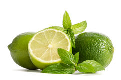 Green mint, two limes with half of a juicy lime Royalty Free Stock Images