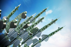 Green missiles aimed for the sky. 3D illustration Royalty Free Stock Photos