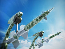 Green missiles aimed for the sky. 3D illustration Stock Photos