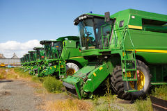 green modern combine harvester on stubble field at end of summer. Royalty Free Stock Images