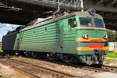 Green modern Russian locomotive with red stripes on cabin Royalty Free Stock Images