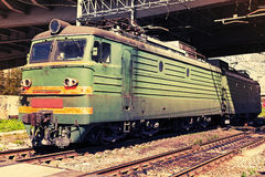 Green modern Russian locomotive with red stripes on cabin Stock Images