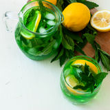 Green mojito cocktail with ice and mint Stock Images