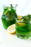 Green mojito cocktail with ice and mint Royalty Free Stock Photos