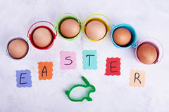 Green mold and Easter eggs. Eggs in colored buckets. Decorations for the celebration of Easter stock photos