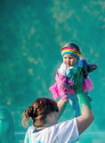 Green  Mom and  baby  at the color run Stock Photos
