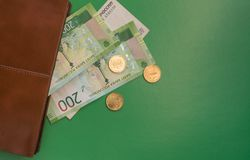 Green money looking out of wallet royalty free stock images
