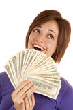 Green money smile. A woman with a fan made out of money with a happy expression on her face Royalty Free Stock Photo