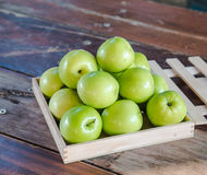 Green monkey apple   put on wooden table Royalty Free Stock Images