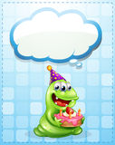 A green monster with a cake thinking Stock Images