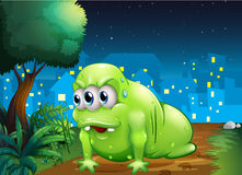 A green monster crawling at the ground in the city. Illustration of a green monster crawling at the ground in the city Stock Photo