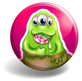 Green monster eating lolipop Royalty Free Stock Images