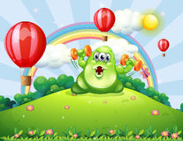 A green monster exercising at the hilltop with floating balloons Stock Images