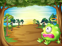 A green monster at the forest resting under the tree. Illustration of a green monster at the forest resting under the tree Stock Images