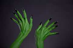 Green monster hands with black nails, real body-art Royalty Free Stock Image