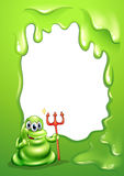 A green monster holding a death fork Royalty Free Stock Photo