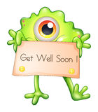 A green monster holding a get-well-soon signage. Illustration of a green monster holding a get-well-soon signage on a white background Stock Images