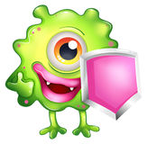 A green monster holding a shield Royalty Free Stock Photography