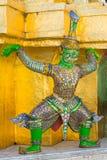Green monster lift the golden pagoda Stock Images