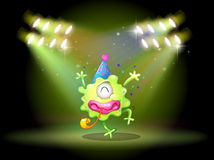 A green monster in the middle of the stage Stock Images