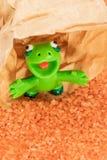Green monster on orange sand Stock Photo