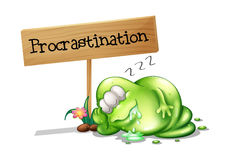 A green monster procrastinating beside a signboard Royalty Free Stock Photos