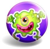 Green monster on purple badge Stock Image