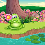 A green monster at the riverbank holding a flower Royalty Free Stock Photography