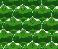 Green monsters seamless pattern. Evil and powerful Goblins. Vekt Stock Photography