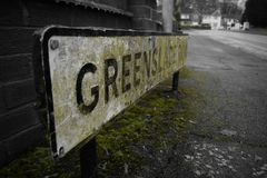 Road sign green white and black Stock Photo