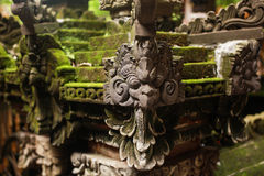 Green Moss and Garuda Statue. Garuda is Large bird-like creature, or humanoid bird that appears in both Hinduism and Buddhism. In Indonesia, every house has this Stock Image