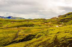 Green moss hills near Nesjavellir Geothermal Power Station in Iceland Royalty Free Stock Images