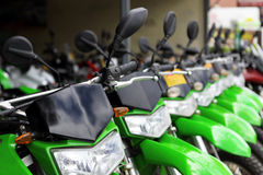 Green Motor Bikes in a Row Stock Images