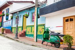 Green motorcycle at the colorful town of Guatape, Antioquia. – Colombia Stock Image