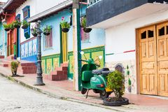 Green motorcycle at the colorful town of Guatape, Antioquia. – Colombia Royalty Free Stock Photos