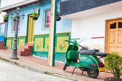 Green motorcycle at the colorful town of Guatape, Antioquia. – Colombia Royalty Free Stock Photography