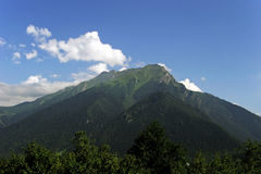Green mountain. Blue sky and clouds (Russia, North Caucasus Stock Photo