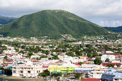 Green Mountain Behind Town on St Kitts Royalty Free Stock Images
